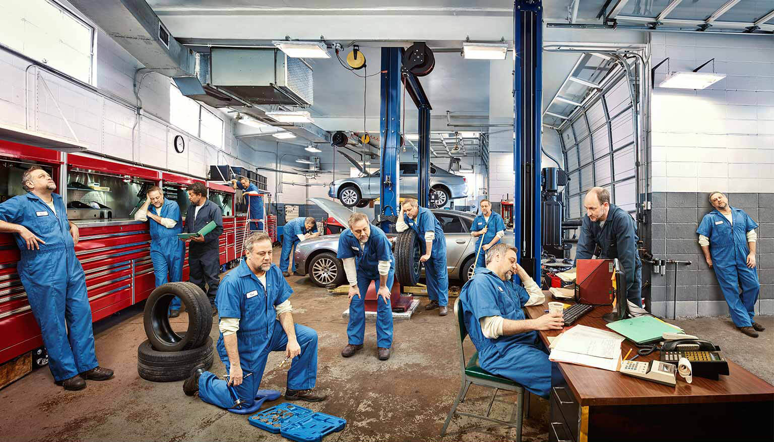 Exhausted mechanic with adult NTM pictured throughout the day at the garage